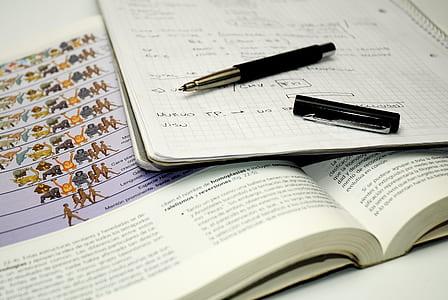black pen beside notebook