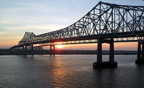 black suspension bridge during sunset