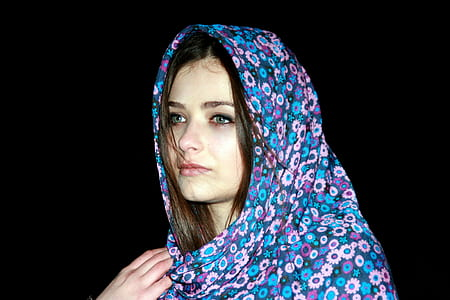 woman wearing blue and pink floral hijab veil