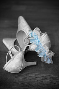 selective color photo of pair of floral kitten-heeled d'Orsay shoes