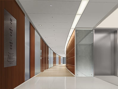 hallway beside brown and silver wall