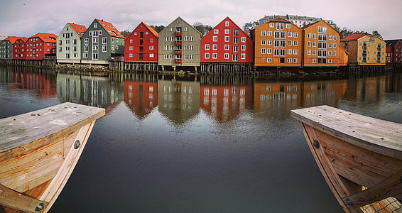 assorted color houses near body of water during daytime