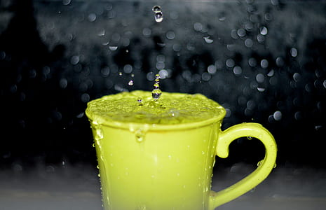 Yellow Ceramic Mug With Water Droplets in Time Lapse Photography