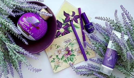 purple makeup kit and purple petaled flowers