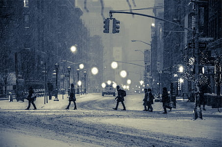 people walking on snow covered street during daytime