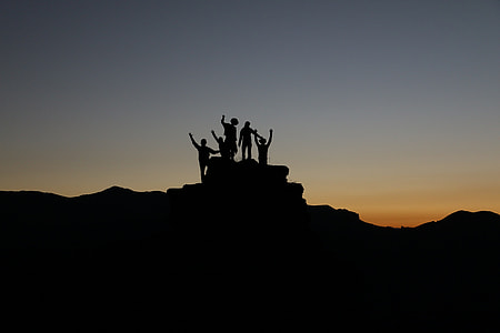silhouette photo of group of people
