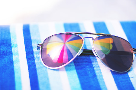 Summer sunglasses on beach towel