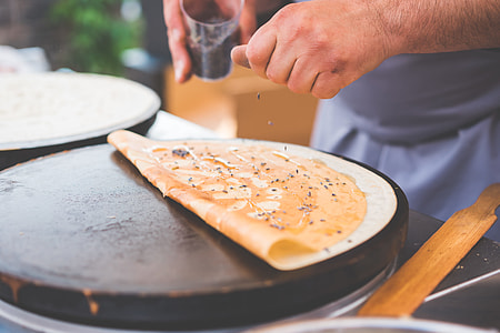 Old Man Making Healthy Crepes in Open Air Market