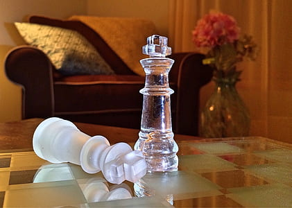 two clear glass rook chess pieces