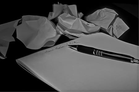 black click pen on white printer paper