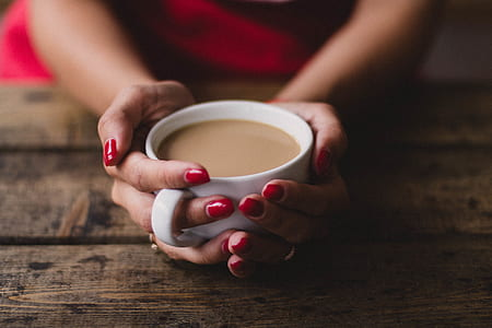 Women Holding Cup Of Coffee