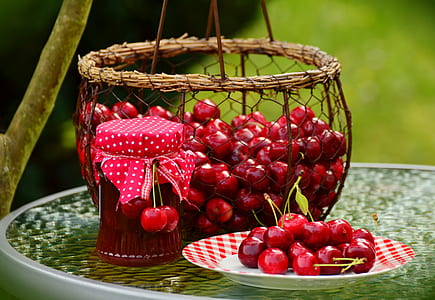 red cherries on baskets
