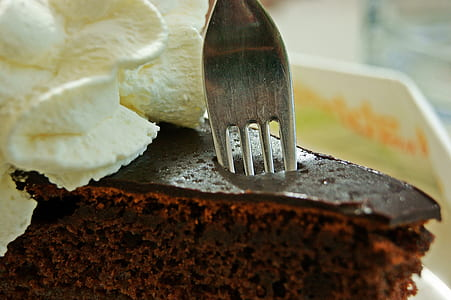slice of brownies with stainless steel forkl