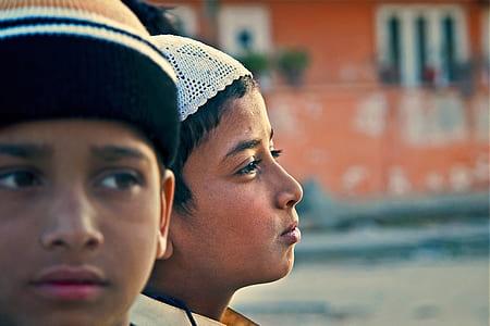 boy wearing white taqiyah