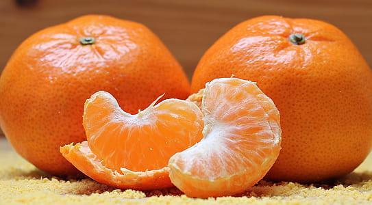 two orange fruits