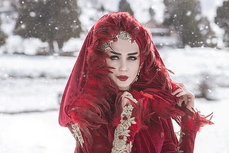 woman wearing red feather dress