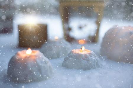 lighted tealight on snow