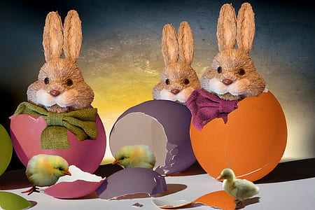 three Easter eggs with rabbits