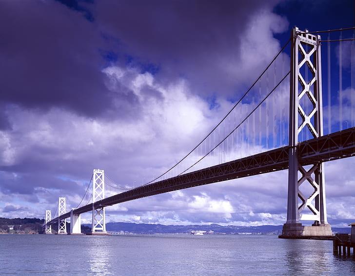 low-angle photography of suspension bridge