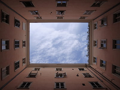 worms eye view of building under cloudy sky