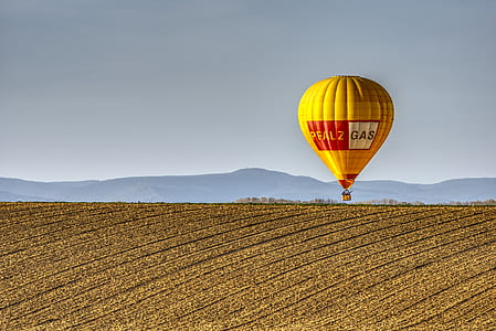 yellow and red hot air balloon during daytime