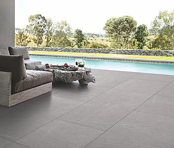 gray suede sofa set near swimming pool