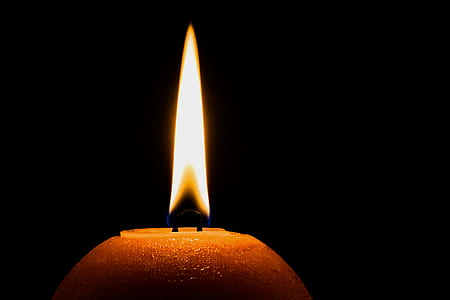 lighted candle during nighttime