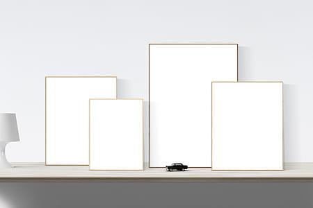 black car scale model beside rectangular white boards