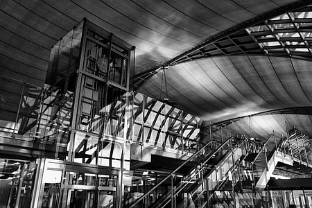 Black and white image captured inside the stunning architecture of the Bangkok Airport, Thailand. The Thai name for the airport is 'Suvarnabhumi'