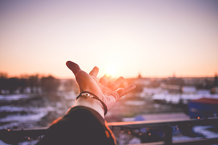Man's Hand is Trying To Reach The Sun