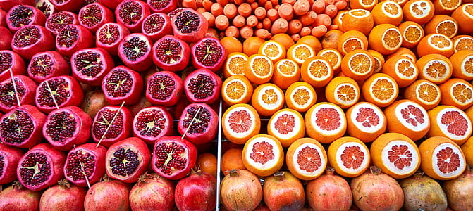 bunch of orange and purple fruits