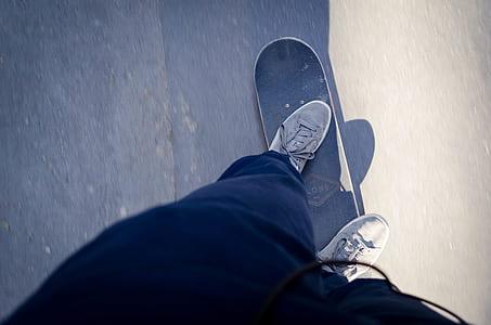 person riding on gray skateboard