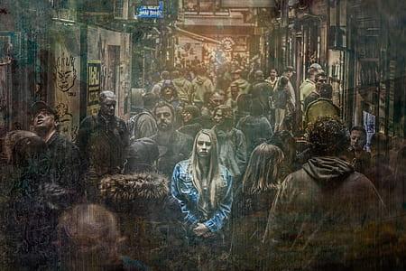 woman wearing blue denim jacket in a crowd of people