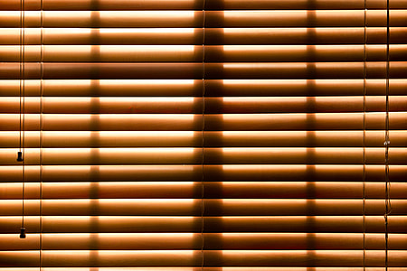 photo of brown window blinds closed