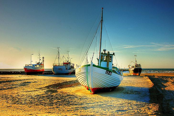 white boat on land