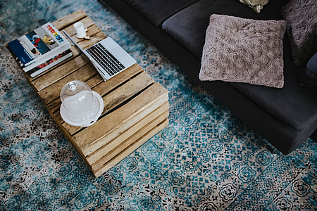 Designer living room interior with a wooden box table and a light blue carpet