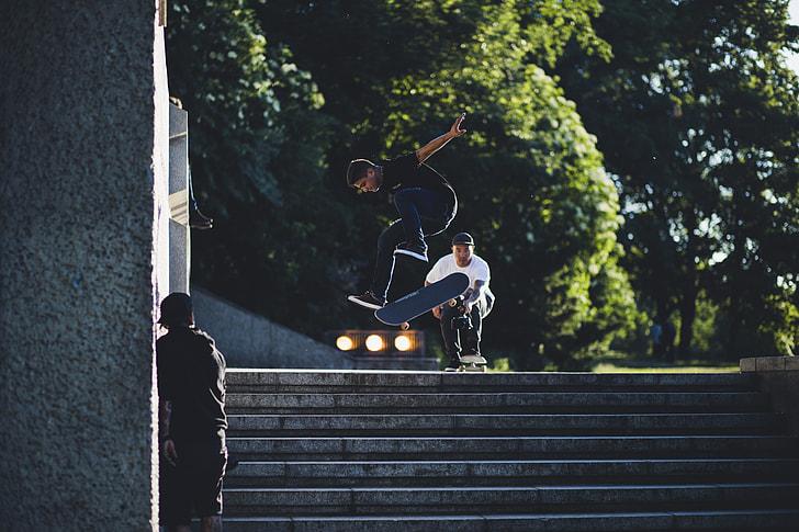 man skating on stairway during daytime