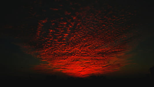 selective color photo of red cirrus clouds