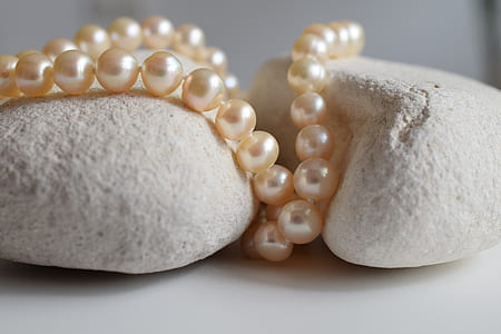 beaded pearl accessory on stones