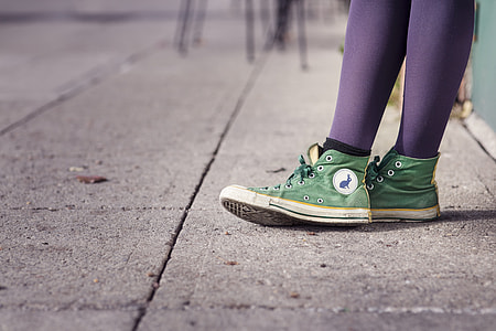 green Converse high-top sneakers