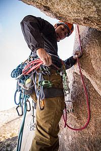 man doing mountain climbing at daylight photography