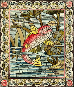 red and yellow fish stained glass art