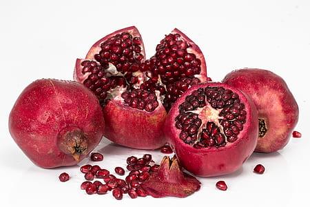 four red pomegranates
