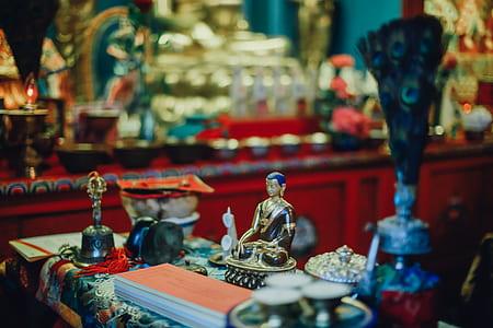 selective focus photography of Hindu Deity figurine