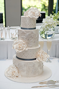 white icing-covered 4-tier cake