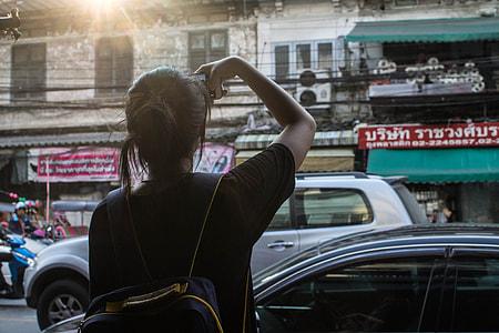 woman in black top in the street