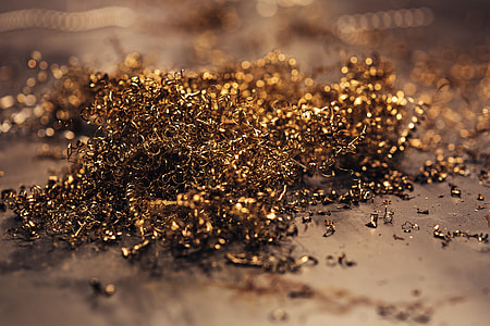 Close-ups of golden metal shavings on a table