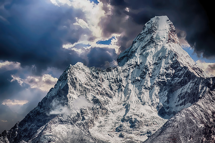 grey mountain filled with snow