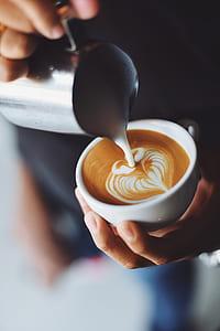 person making cappuccino