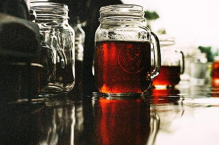 three clear glass mason jars